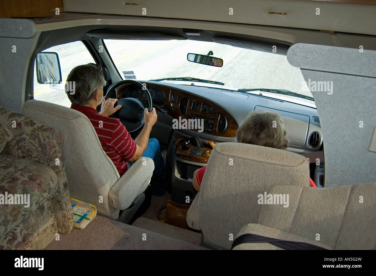 Man and woman in the driver and passenger seats driving