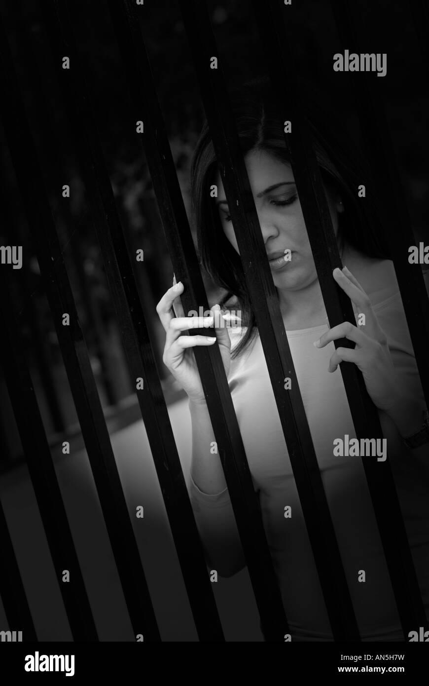 woman behind bars - Stock Image