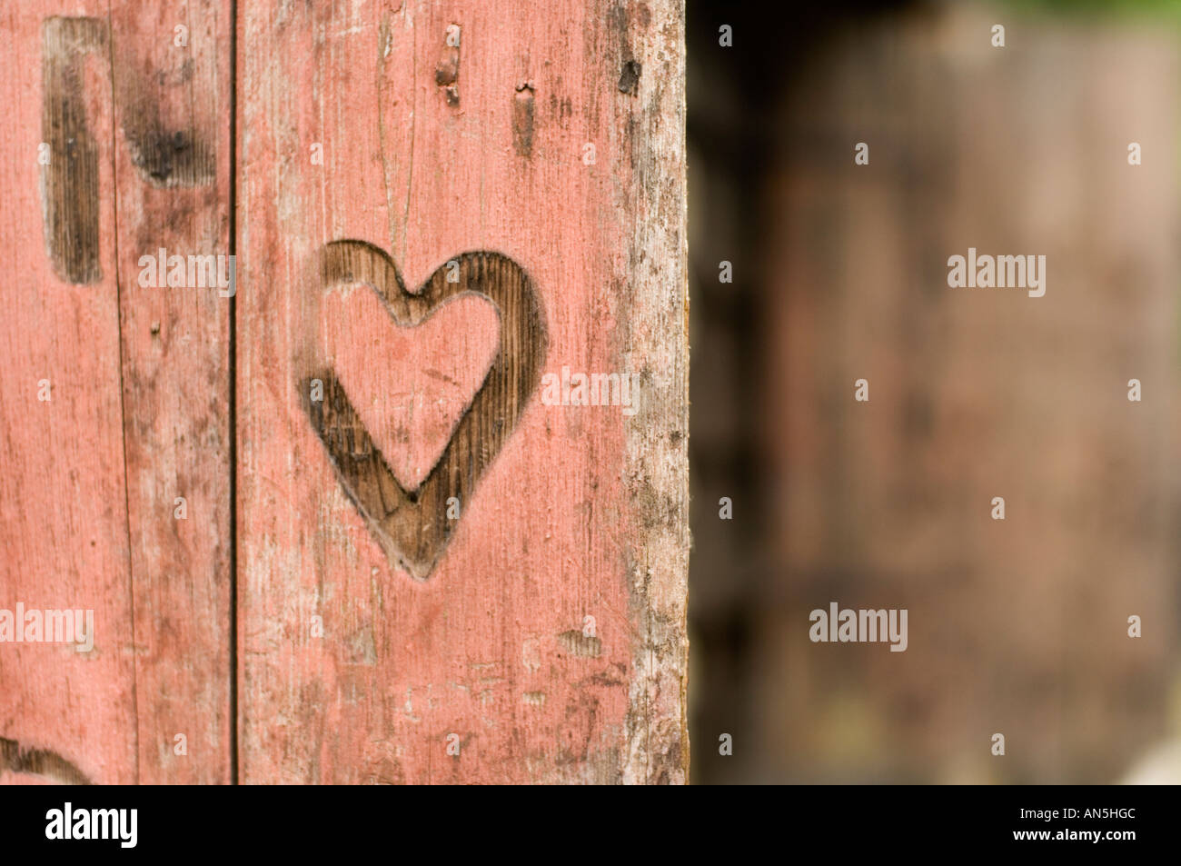 a Heart mark burnt branded scorched into the wooden shutters on old blacksmith's shop Penybont Powys wales UK - Stock Image