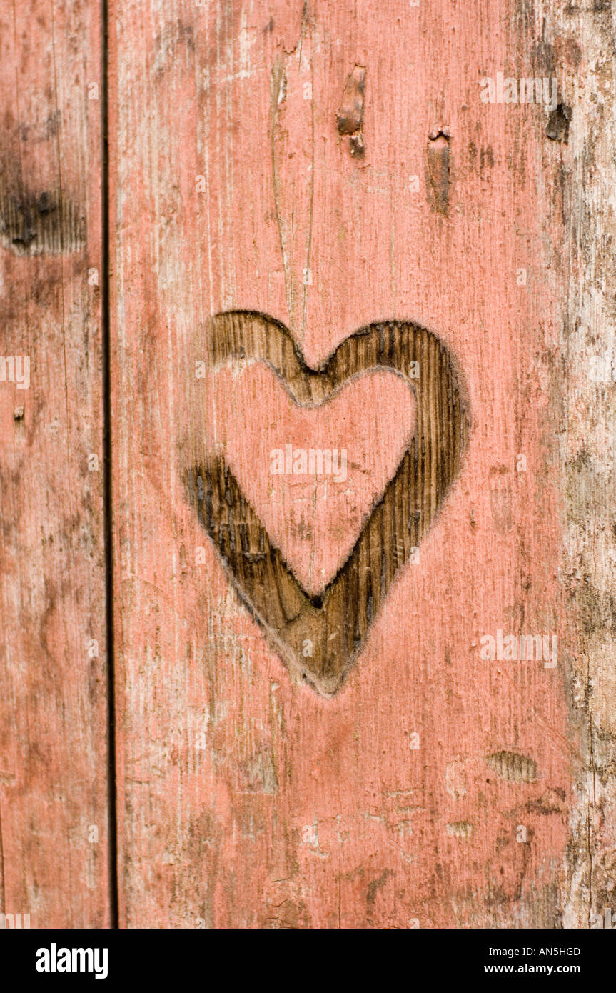 a Heart mark burned branded scorched into the wooden shutters on old blacksmith's shop Penybont Powys wales,UK - Stock Image