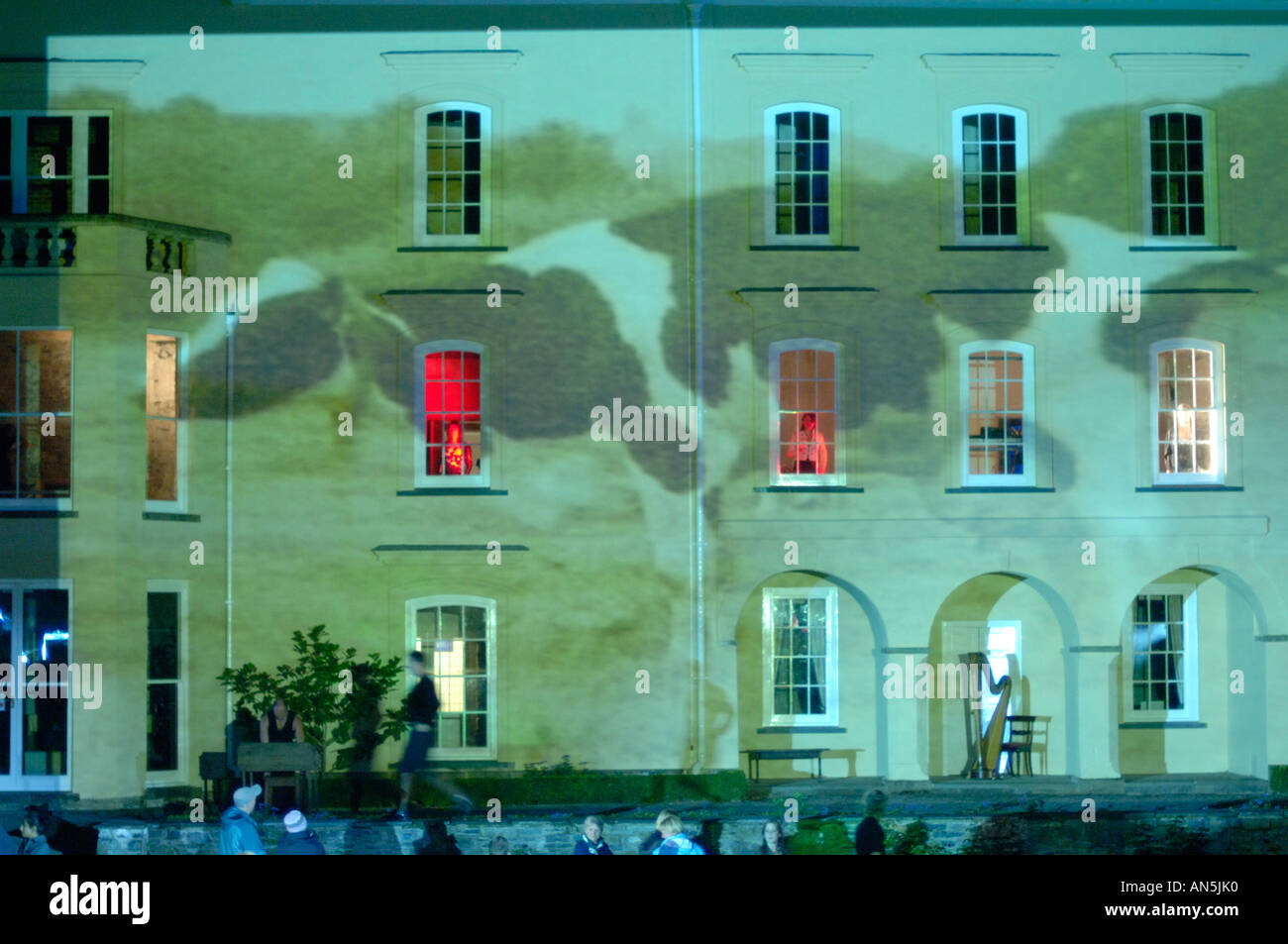 Young actors performing at Aberglasney Gardens Llandeilo Carmarthenshire Wales UK - video projection on the facade of the house - Stock Image
