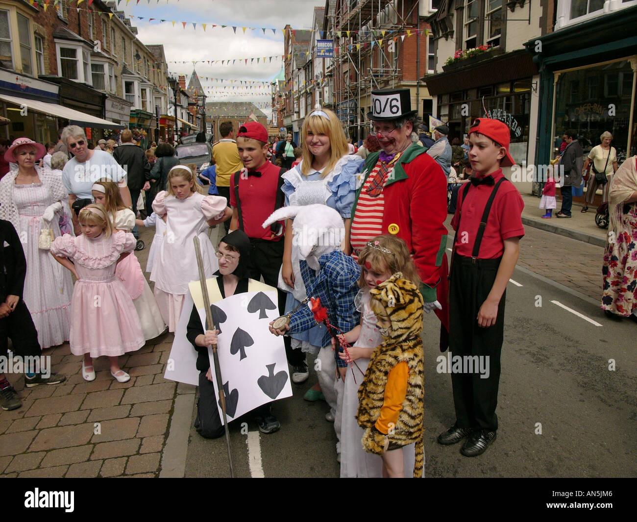 Llandrindod Wells victorian festival Powys Wales - alice in wonderland characters awaiting judging at the end of the parade - Stock Image