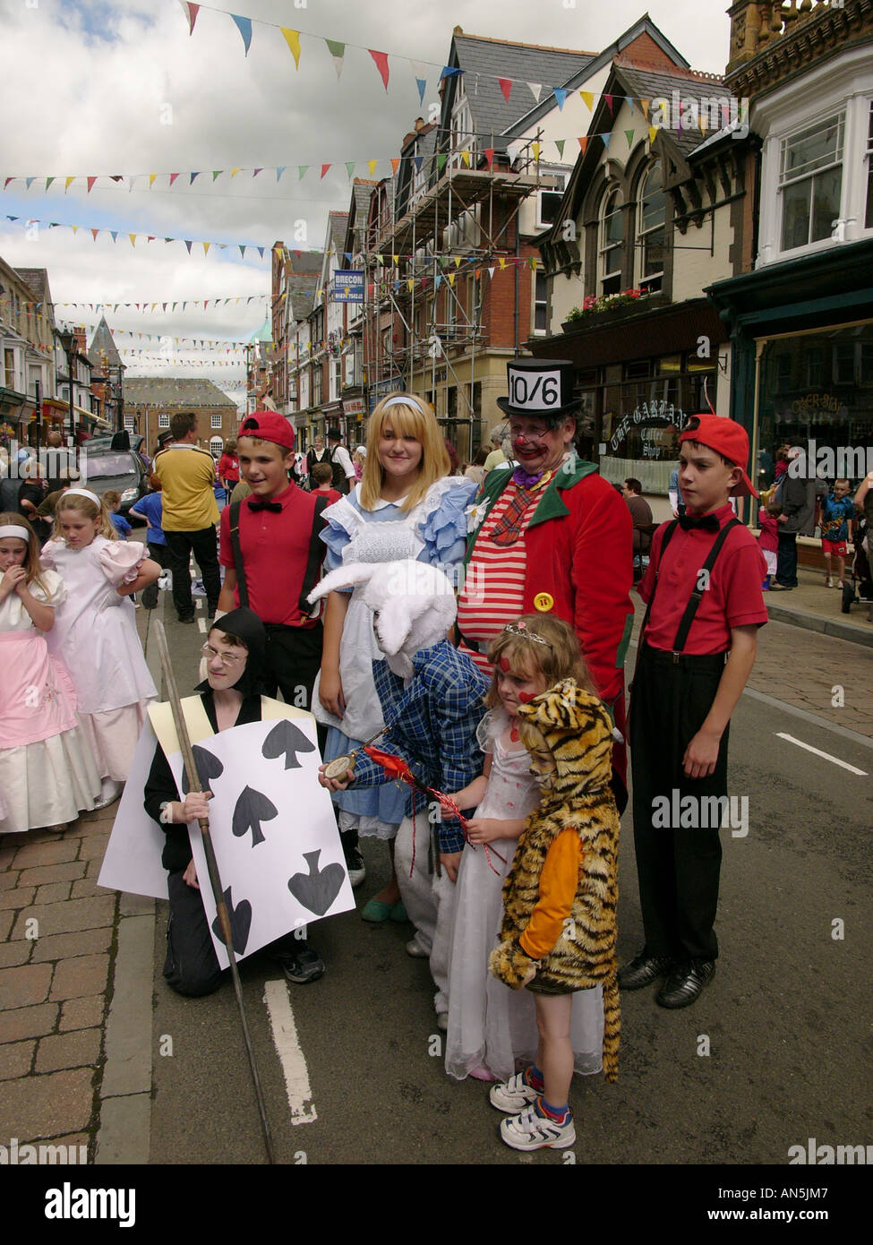alice in wonderland characters awaiting judging at the end of the parade at Llandrindod Wells victorian festival Powys Wales UK - Stock Image