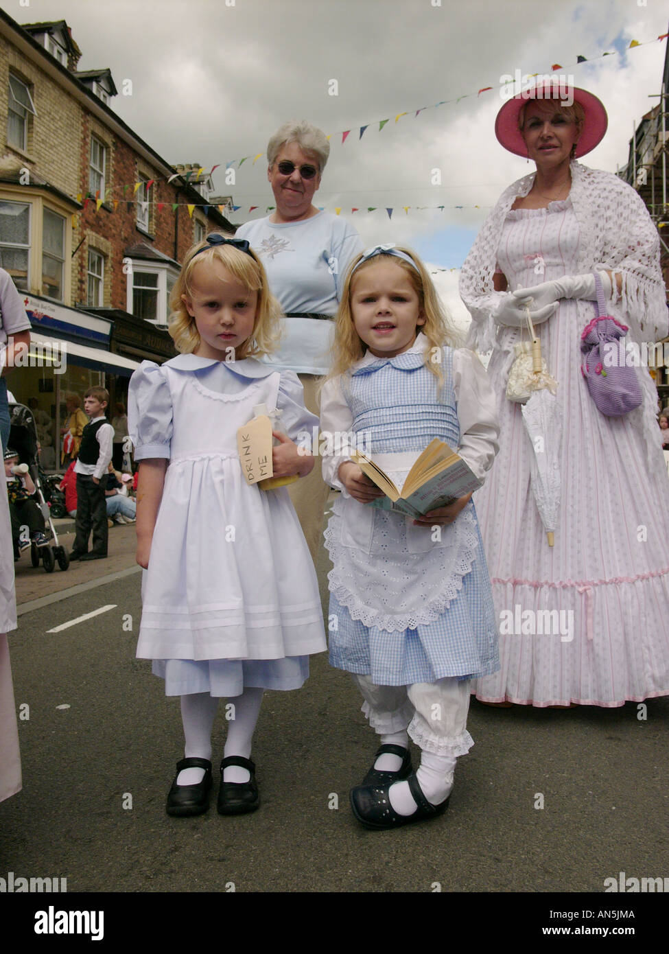 Llandrindod Wells victorian festival Powys Wales - girls dressed as characters from a Lewis Carol book Alice in Wonderland - Stock Image