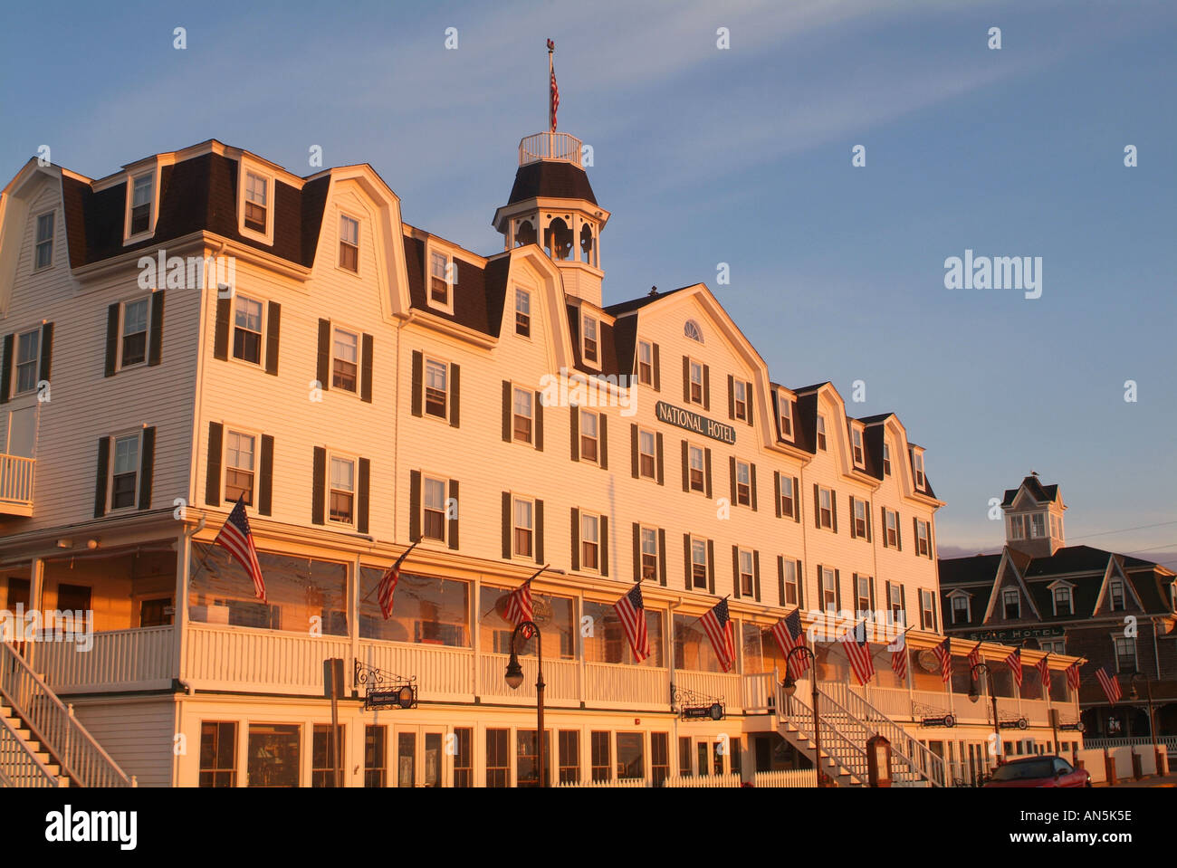 The National Hotel, Block Island, Rhode Island with Flags Historic Inn at Dawn - Stock Image
