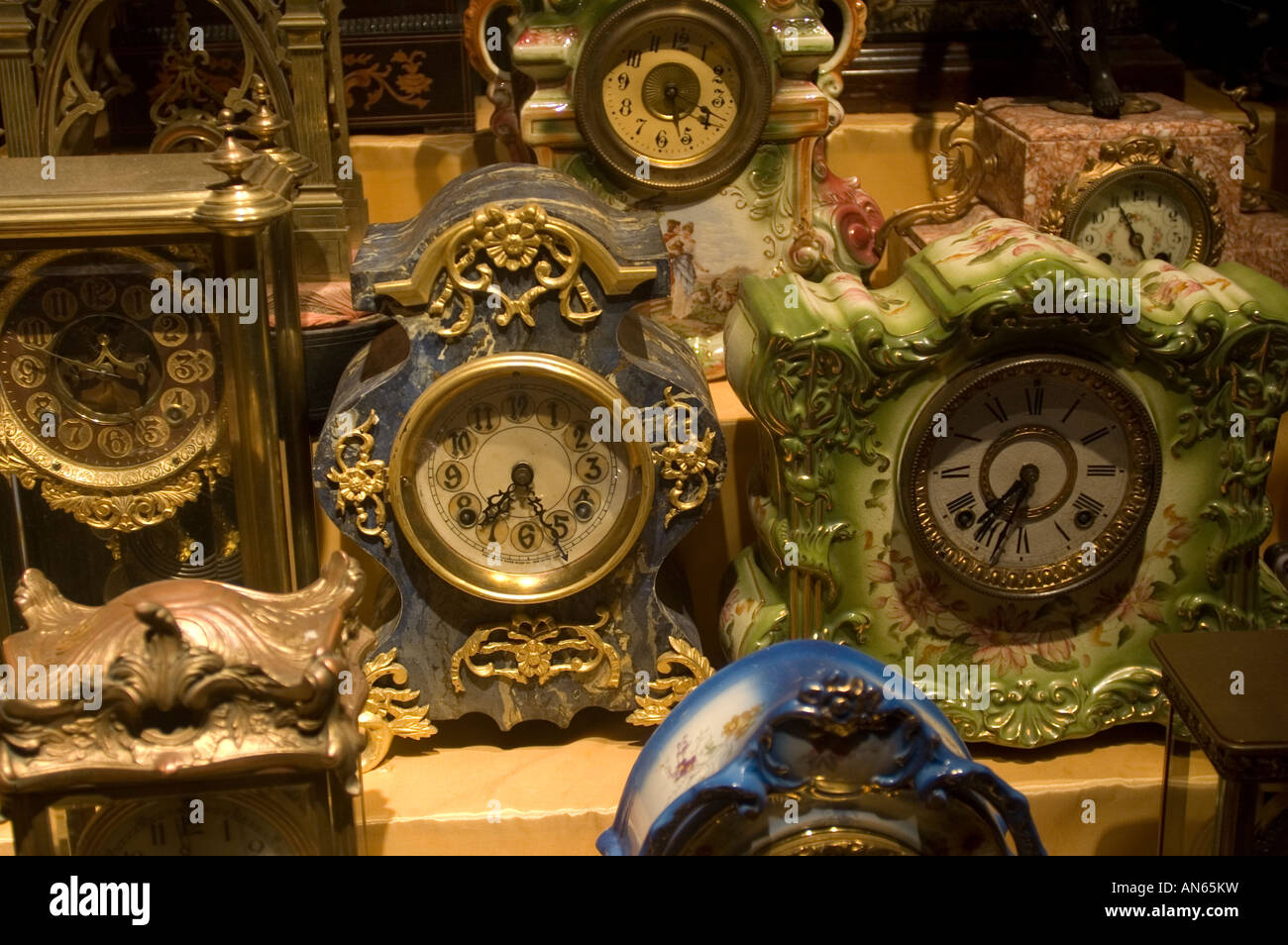 A collection of rococo clocks in a store window in the NYC neighborhood of Chelsea - Stock Image
