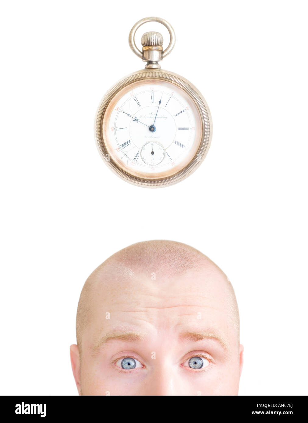 Part of a man's head and a stop watch - Stock Image