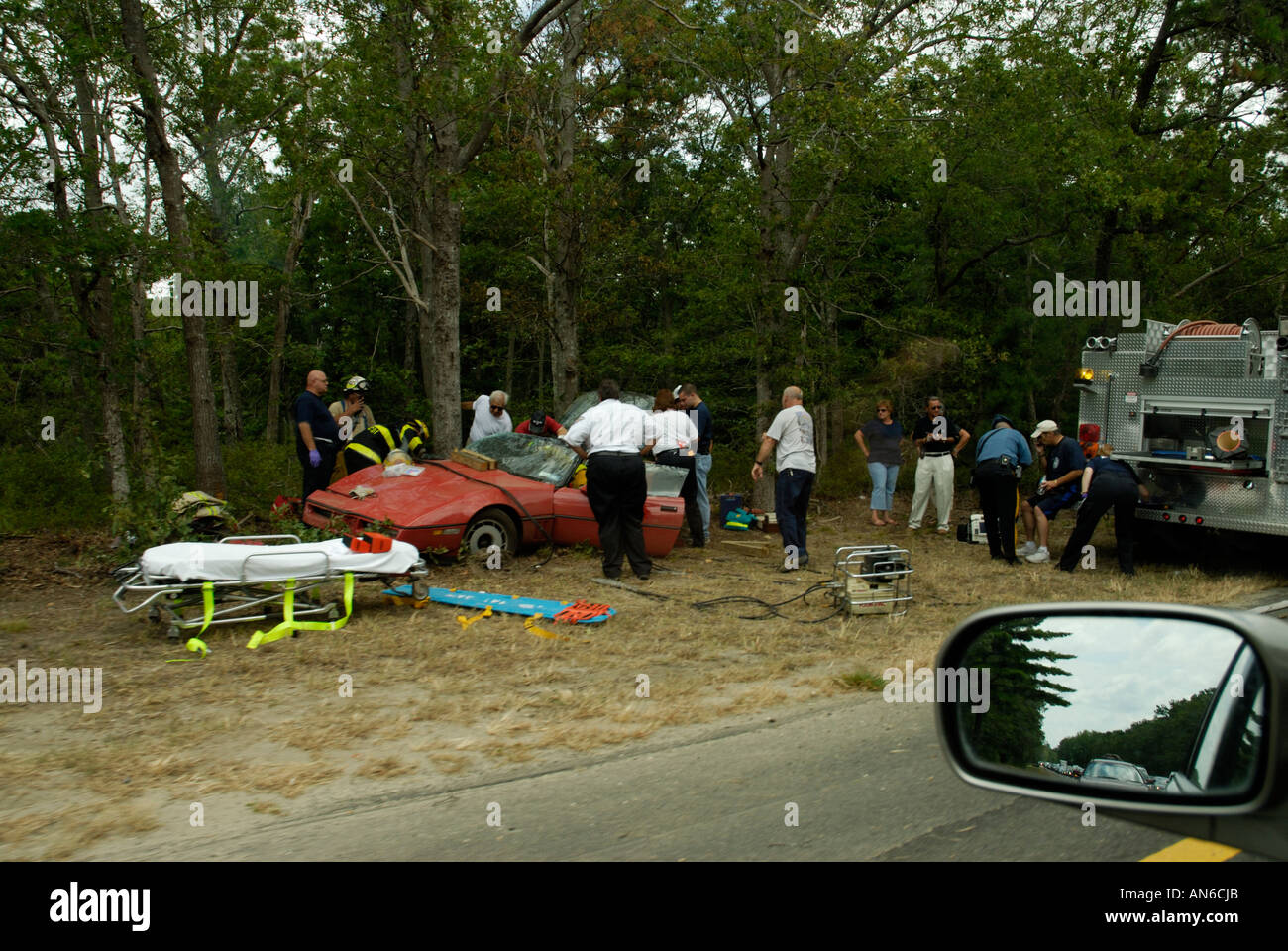 Emergency workers responders at scene of car accident - Stock Image