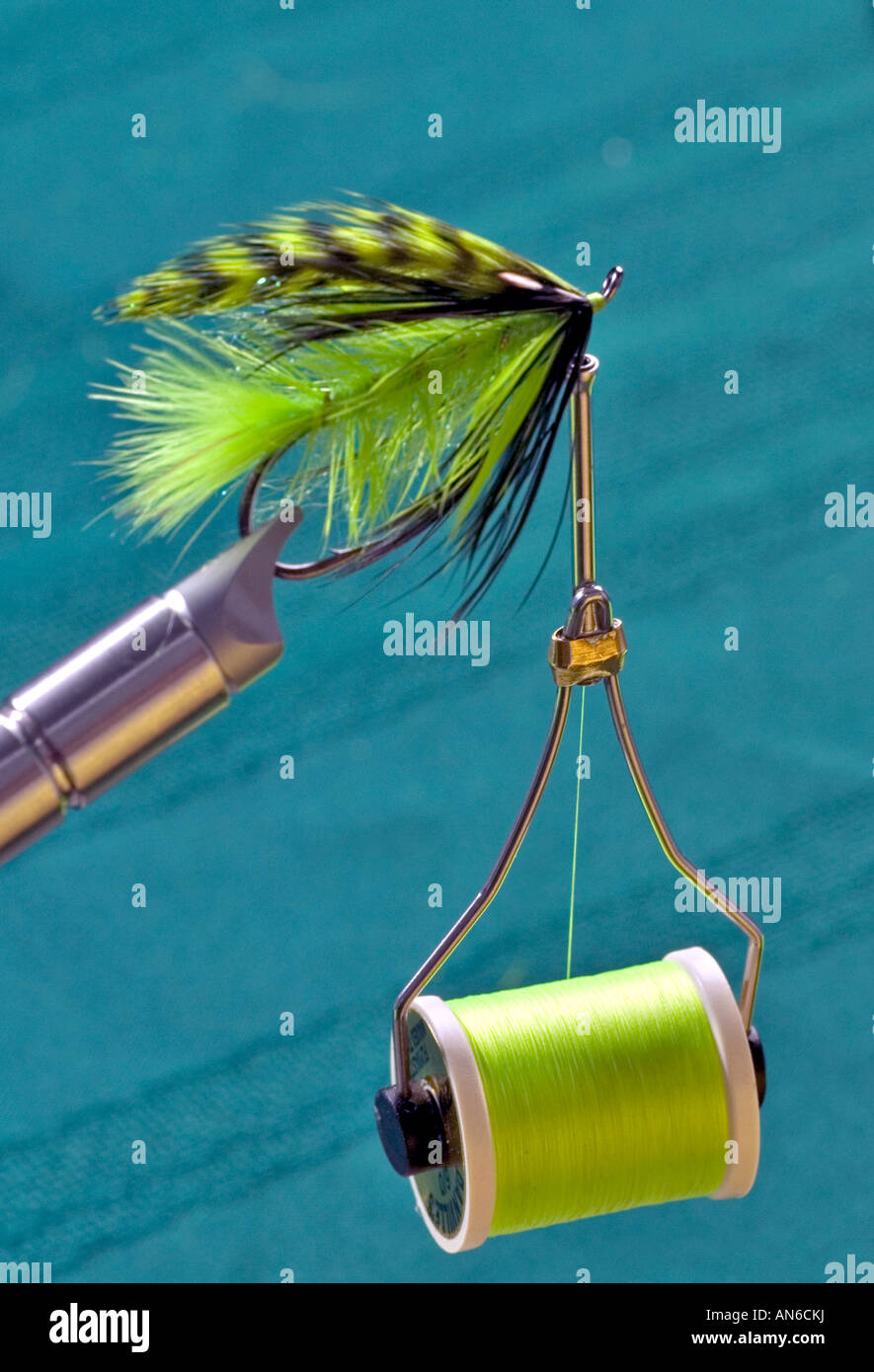 Metal instrument with spool of thread, close-up - Stock Image