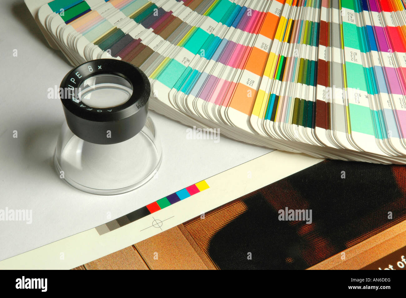 A color swatch book with a loupe and a printing proof Stock Photo ...