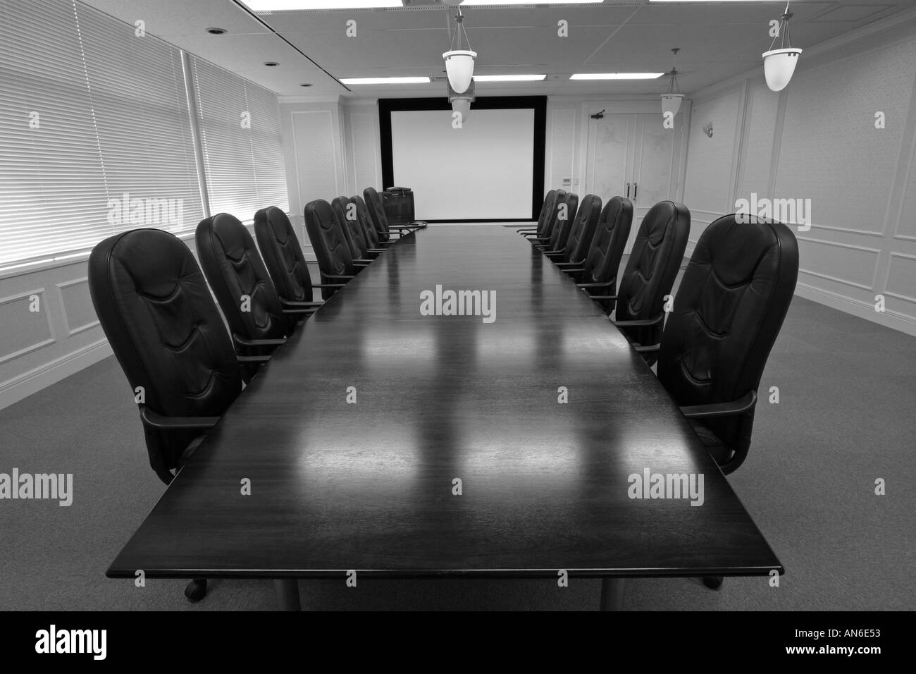 Long Wooden Boardroom Table Surrounded By Expensive Leather Chairs - Large boardroom table