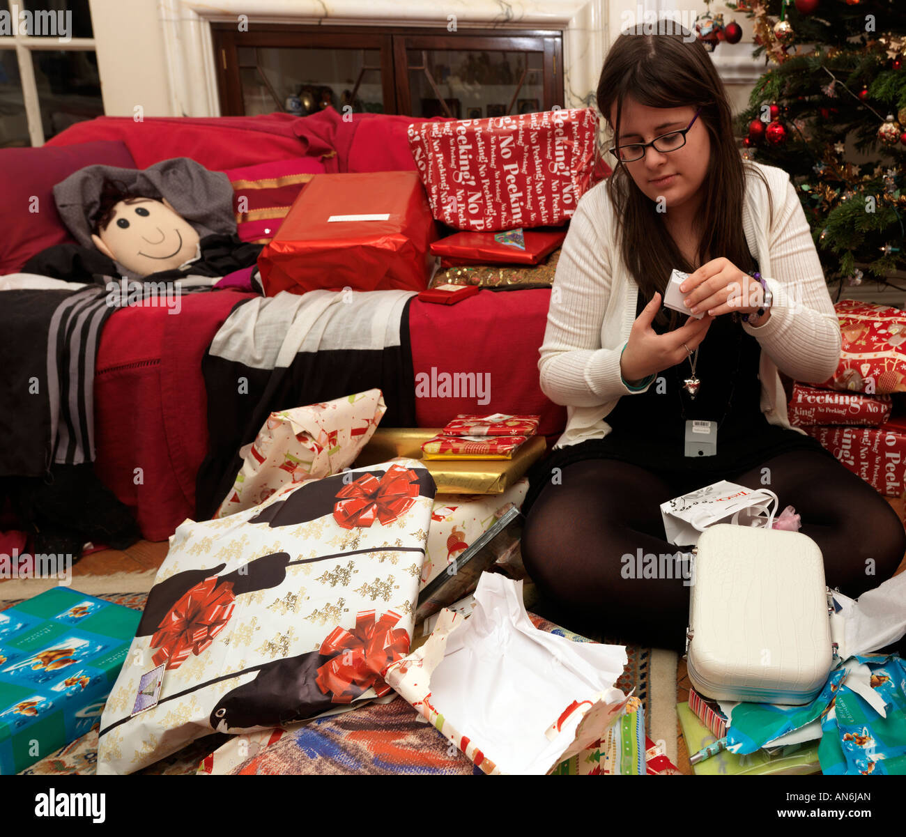 Teenager Opening Presents Christmas Morning - Stock Image