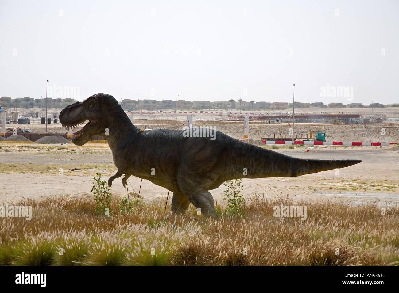 construction site with dinosaur for Dubailand amusement park Dinosaurier mitten in der Baustelle des Vergnuegungsparks - Stock Image