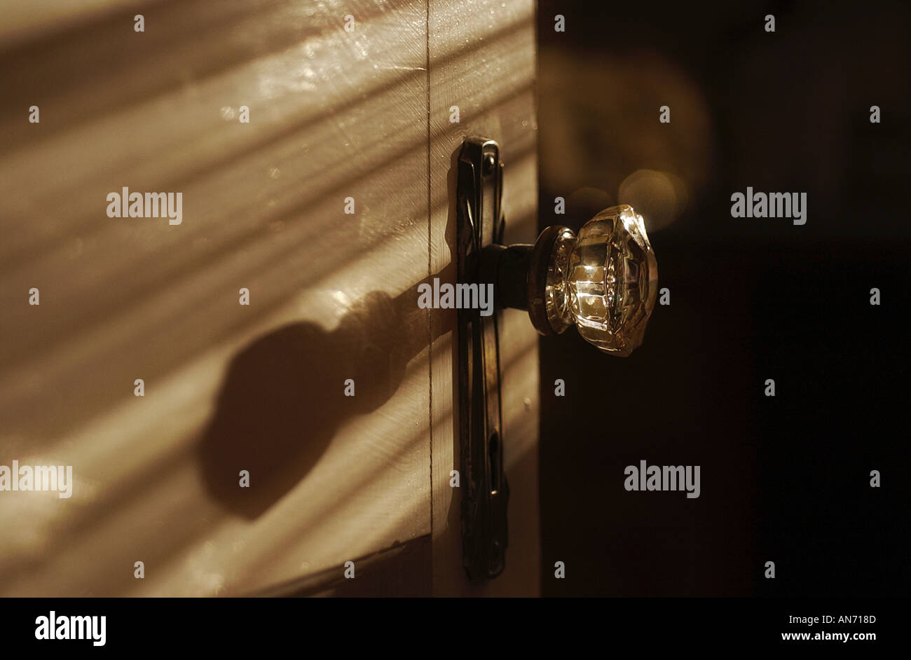 A clear glass antique door knob with dramatic shadows - Stock Image