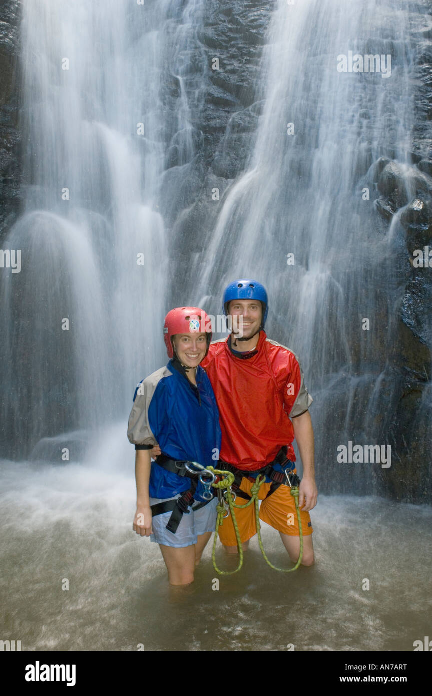 Couple finished rappelling down waterfall, Explornatura, Turrialba COSTA RICA - Stock Image