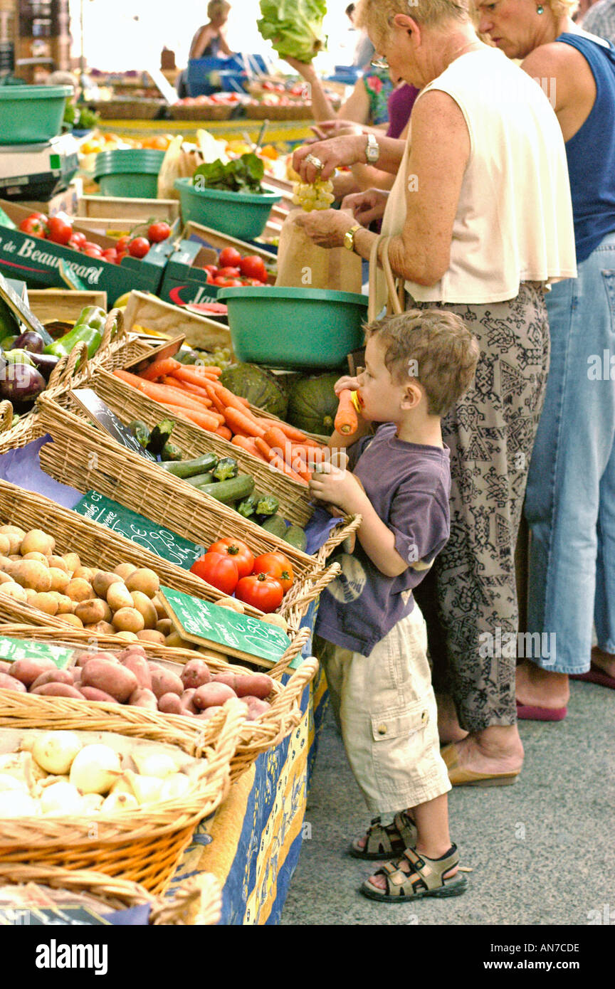 Child Smelling Food in Montpellier FRANCE, Outdoor Food Market in Fresh Vegetables, Farmers Market Stock Photo