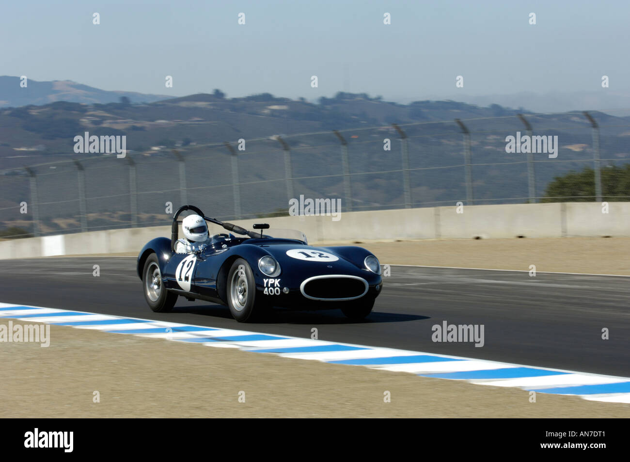 Peter Neumark races his 1955 Cooper Jaguar T38 at the 33rd Rolex ...