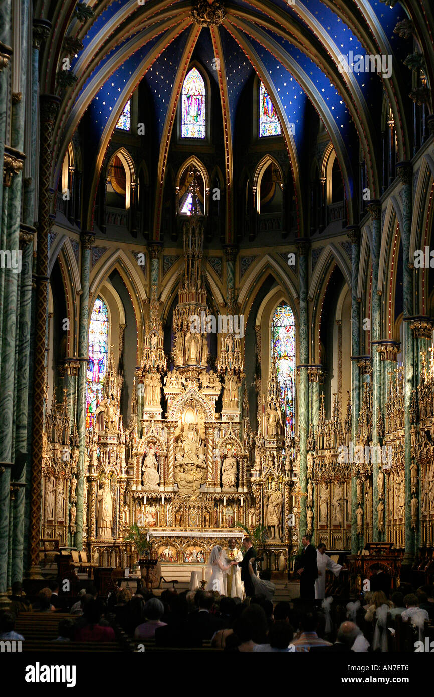 Heady Responsibility:  Marriage in the Cathedral A couple is married amidst the splendor of Ottawa's Basilica - Stock Image