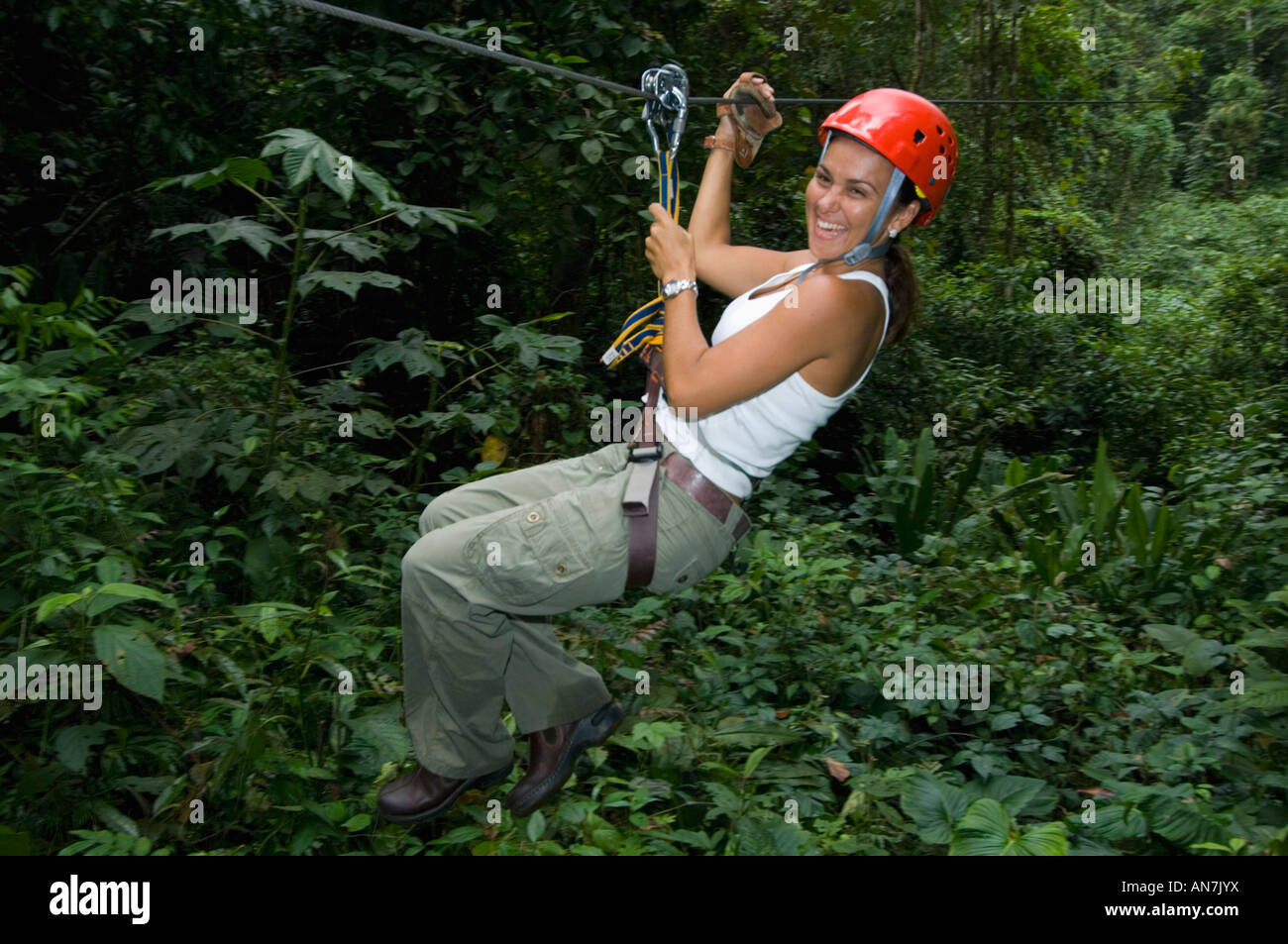 Woman on canopy zipline, Aventuras del Sarapiqui, Costa Rica - Stock Image