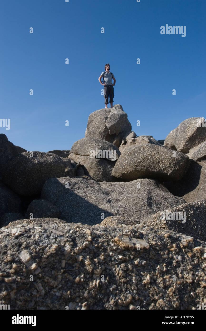 Man Standing on Rock - Stock Image