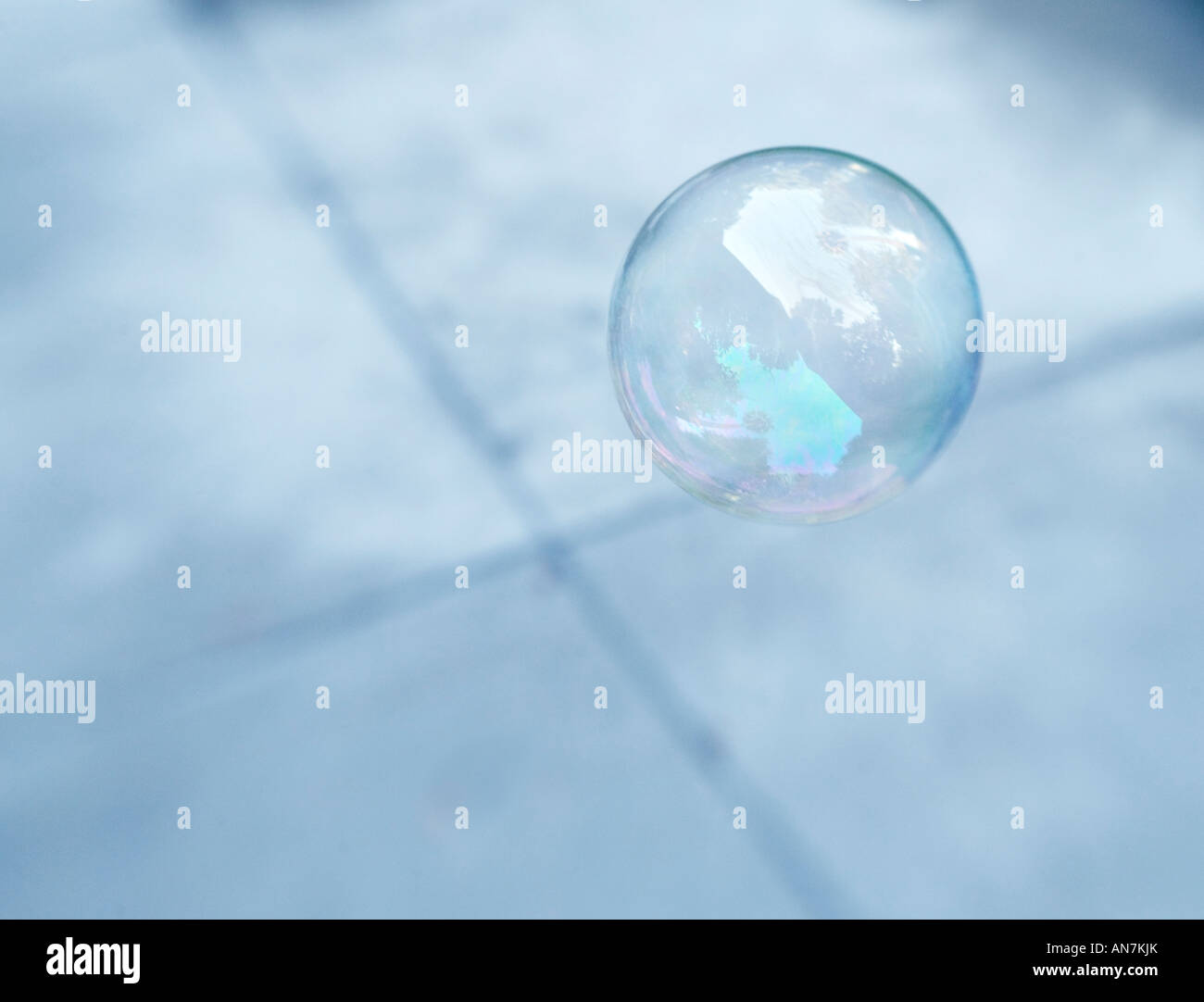 floating bubble made from soap over x pattern - Stock Image