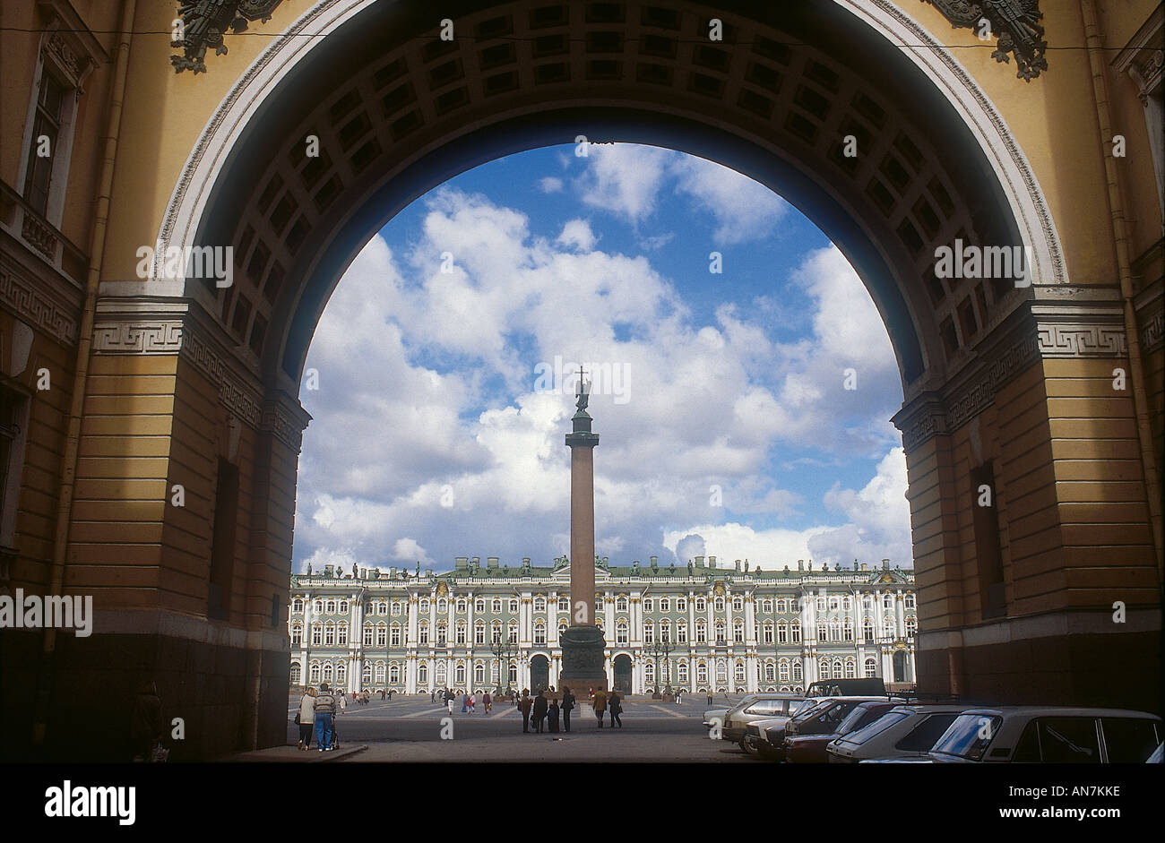 Part of the facade of the Hermitage viewed beyond the Alexander Column through the archway of the former General Staff Building in Palace Square - Stock Image