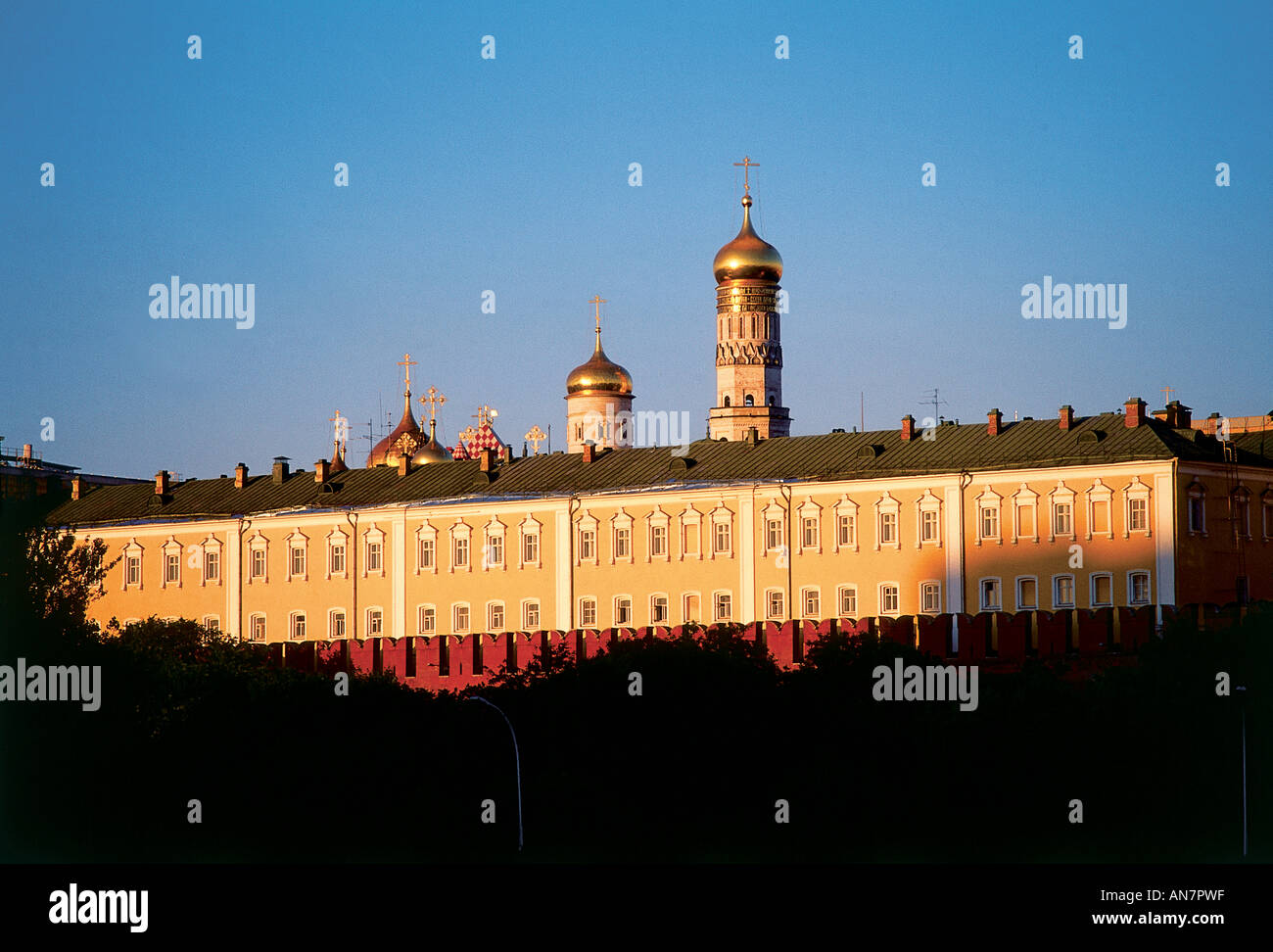 Viewed from the adjacent riverside low sun striking the facade of The Armoury commissioned by Nicholas I in 1851 as an extension to the Great Kremlin Palace Moscow - Stock Image
