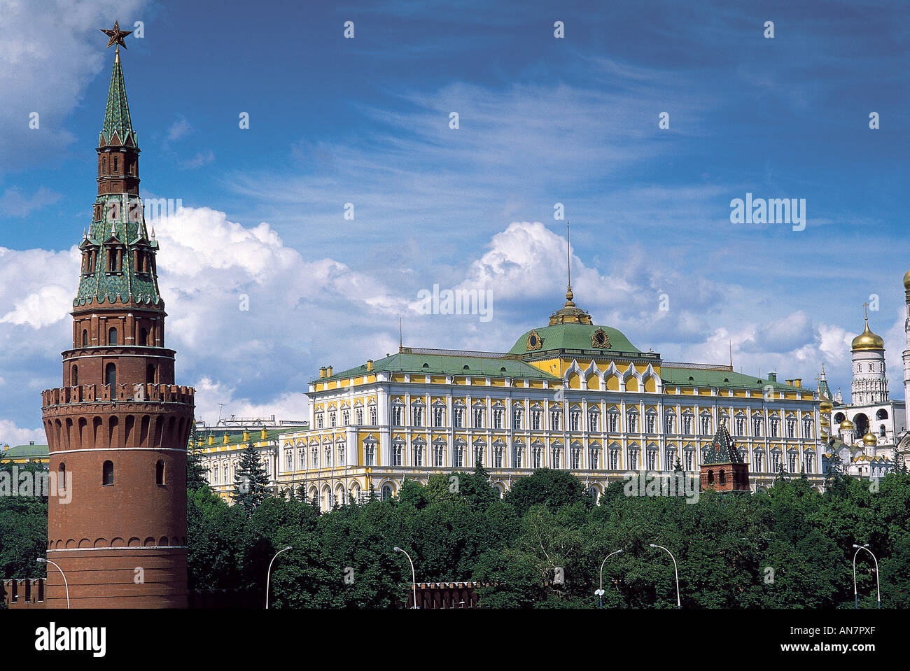 Located behind a bank of trees pierced by towers are the Russo Byzantine yellow walls of the Great Kremlin Palace which was built for Nicholas I in1838 49 and now serves as the meeting place for the Supreme Soviet Moscow - Stock Image