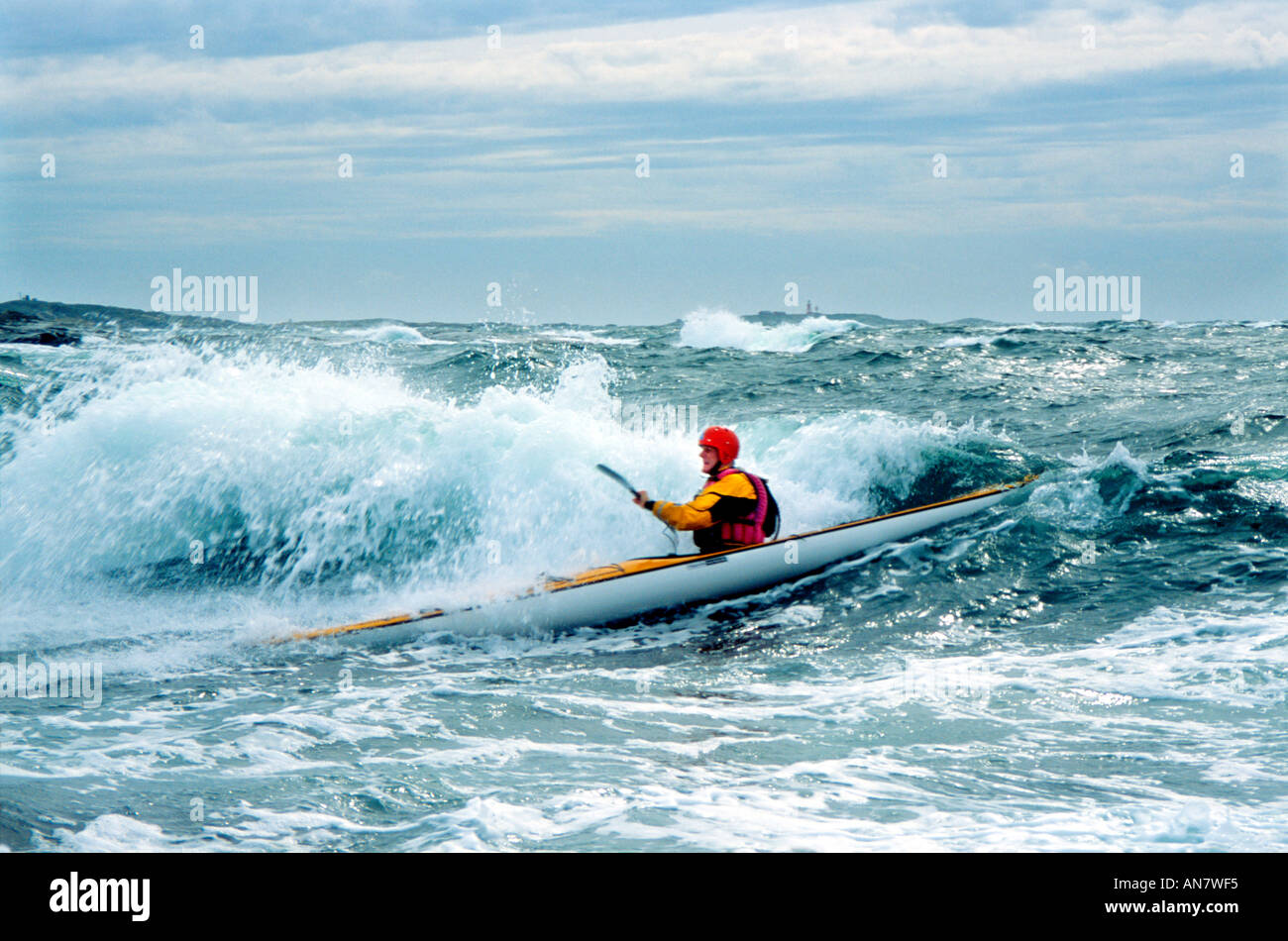 Advanced sea kayaking goes beyond comfortable paddling on placid waters on a sunny summer day Orost Bohusland Sweden Stock Photo