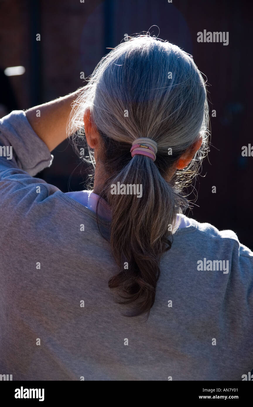 Back View Of Single Older Woman Looking Into Sun Grey Hair In Stock