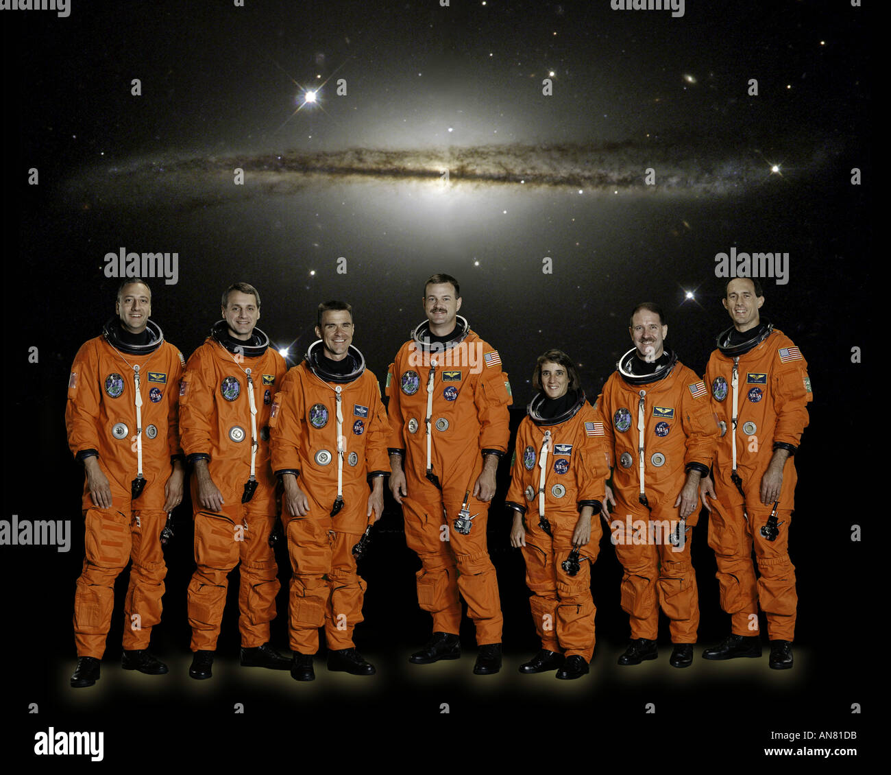 Seven astronauts  STS 109 mission pose traditional pre-flight crew portrait - Stock Image