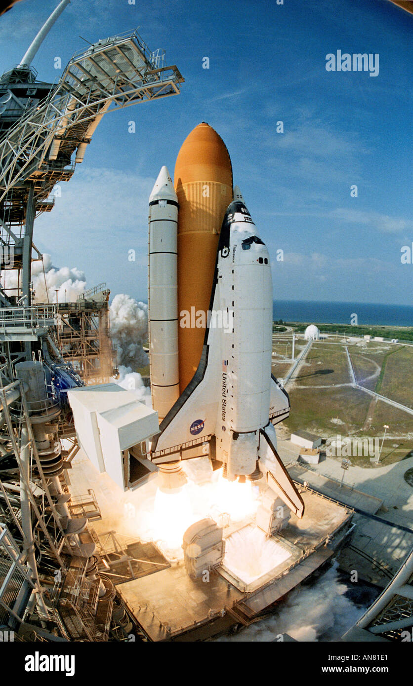Space Shuttle Endeavour lifts off creating billows of smoke and steam on its way into space for mission STS 111 - Stock Image