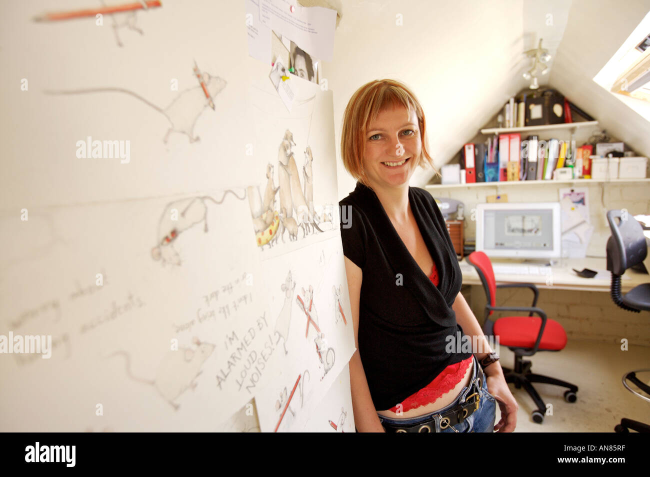 Emily Gravett a childrens book author and illustrator pictured in her attic studio office at her home in Brighton UK - Stock Image