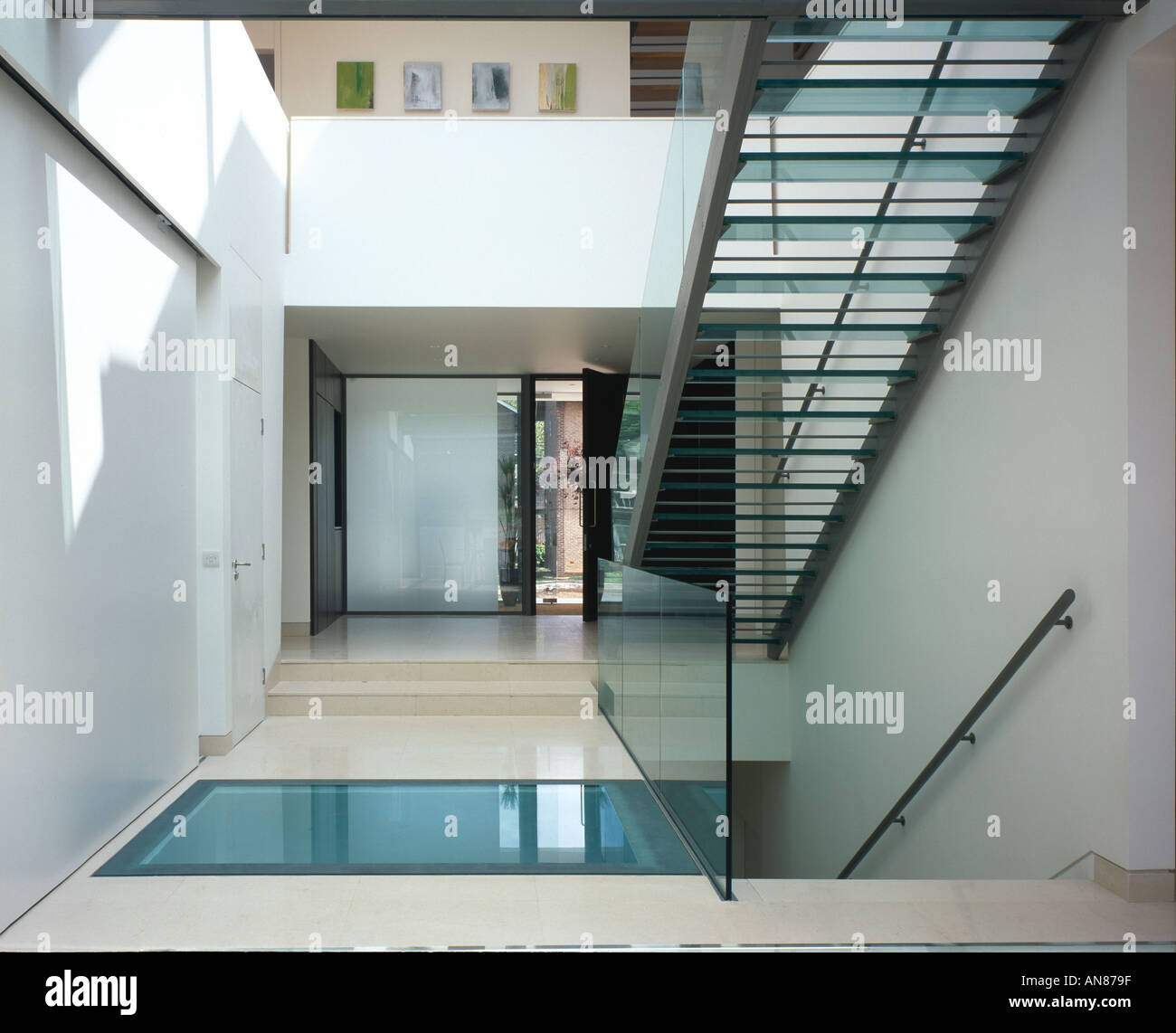 basement pool house. Modern House With Basement Pool, Hampstead - Interior Hall Entrance Staircase. Architect: Belsize Architects Pool N