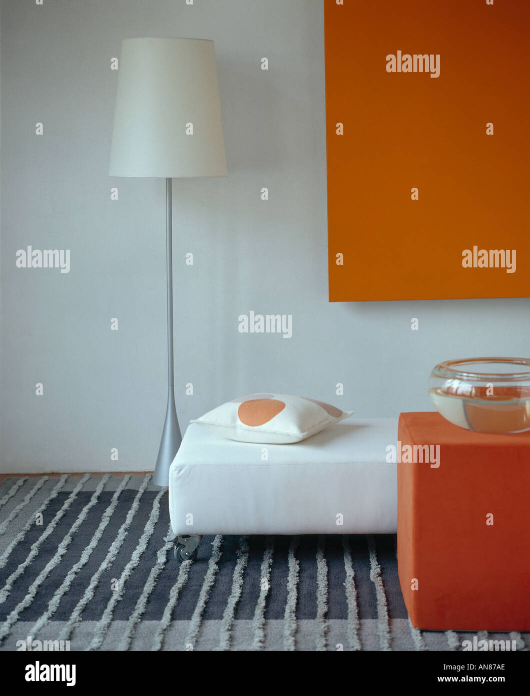 White Living Room With Minimal Lampstand And Orange Accessories ...