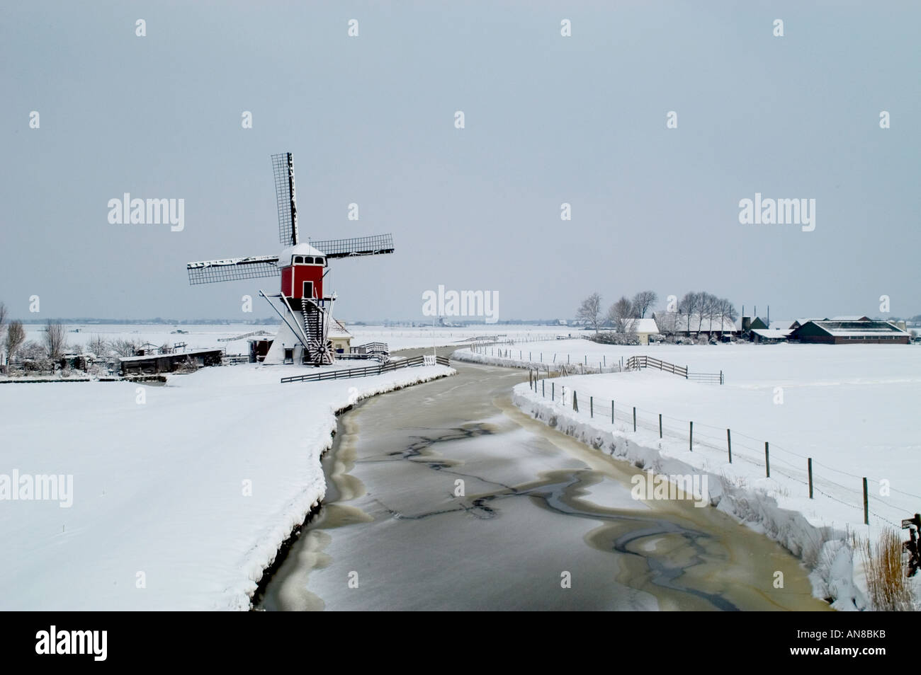 Netherlands Holland Winter Snow Ice Oud Ade windmill - Stock Image