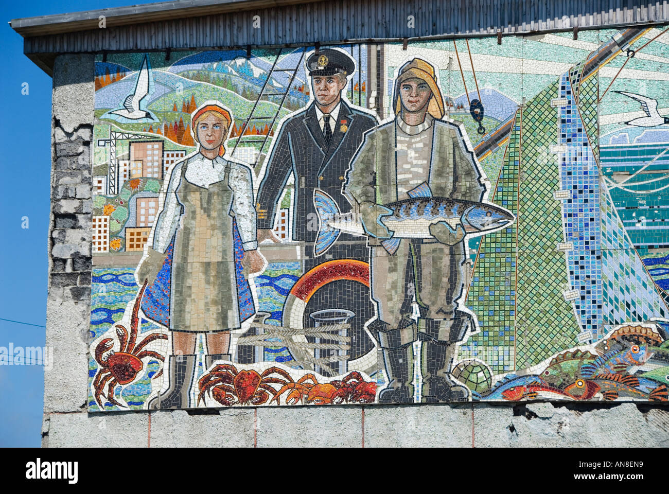 Large soviet era murals with fishing theme on building in Ozersky village on Sakhalin Island Russia - Stock Image