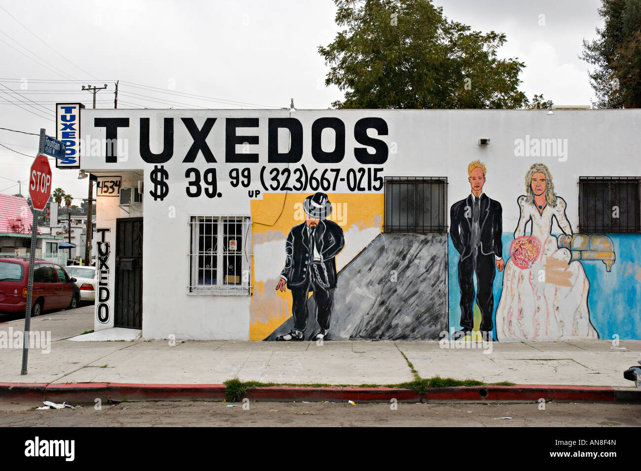 Hollywood, Los Angeles, USA. Mural advertising a back street clothes hire shop for formal wear (weddings etc) - Stock Image