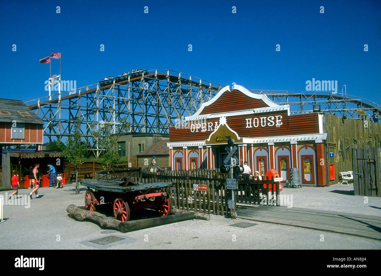 Old western decorations of Frontierland Theme Park amusements Rollercoaster can be seen beyond Old signs and opera Stock Photo
