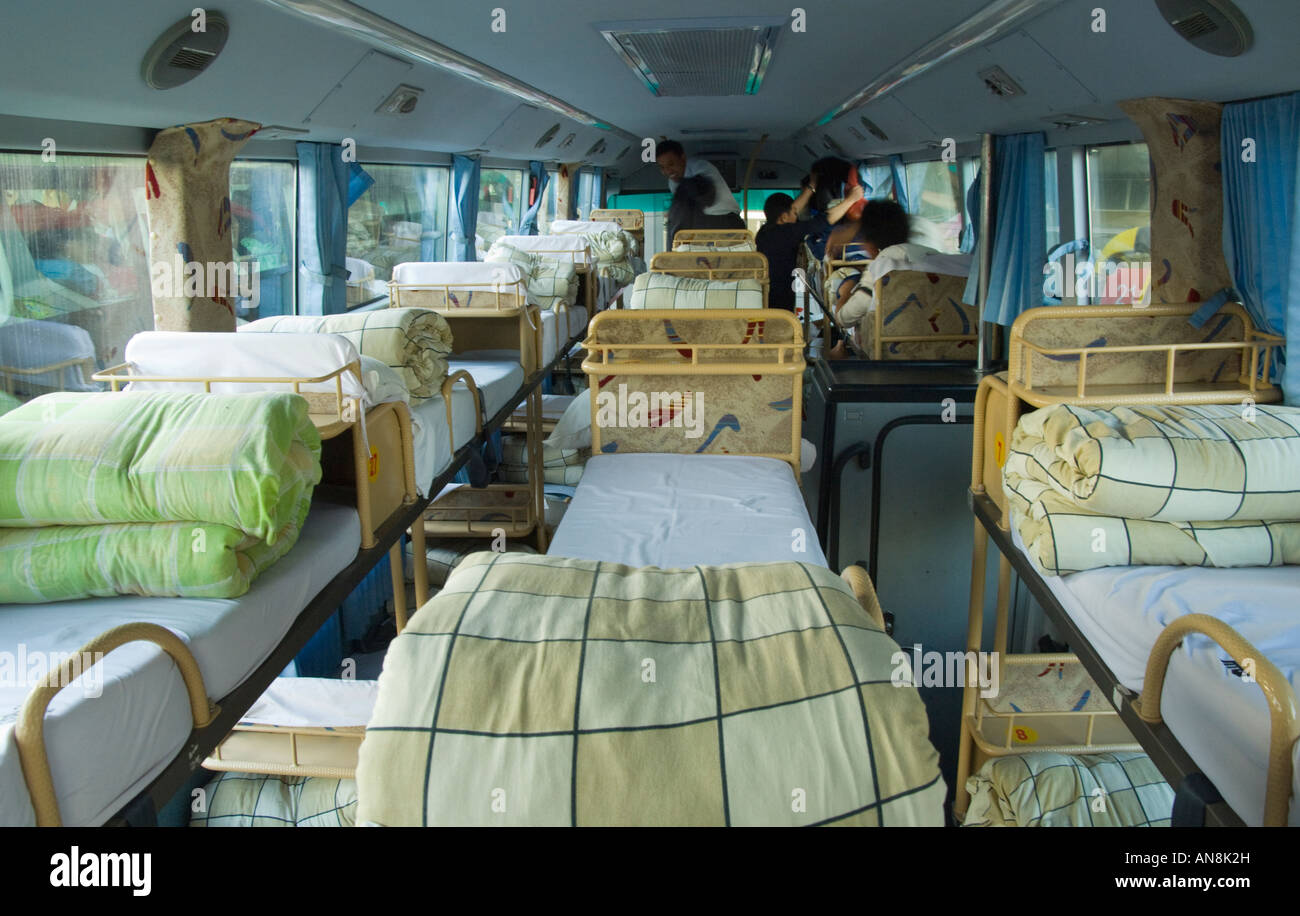 China long distance sleeper bus. Indoor view with sleepers - Stock Image