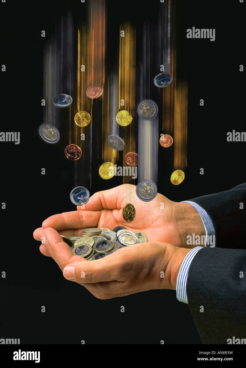 Hands catching european coins - Stock Image