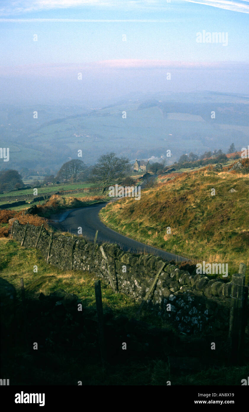 View down Curbar Pass from Curbar Edge towards Curbar village Peak District National Park Derbyshire - Stock Image