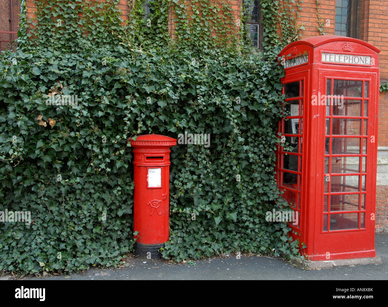 A post box and telephone kiosk are part of English Heritage and a common sight in Britain - Stock Image