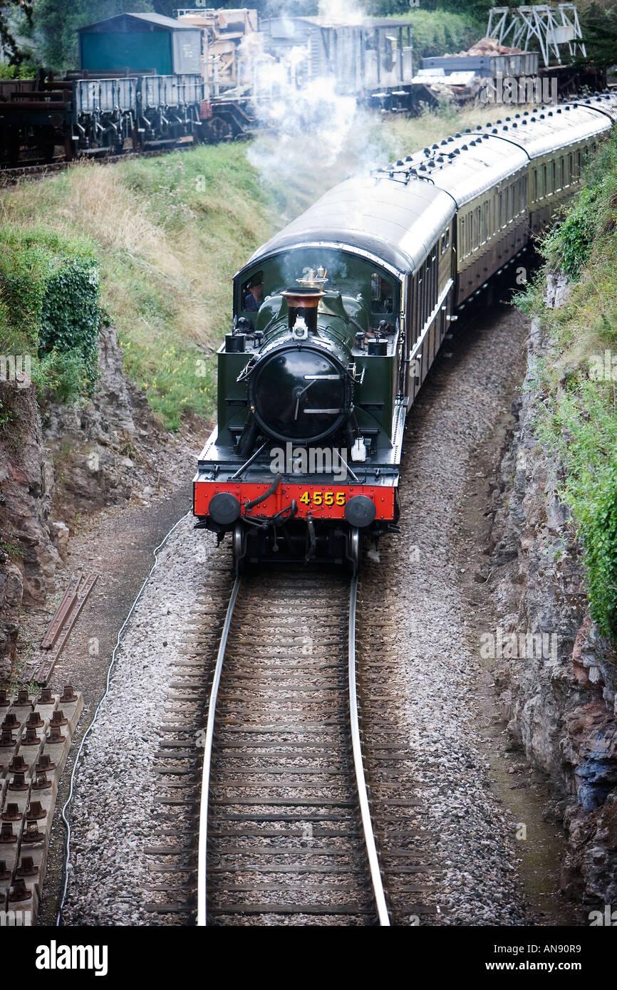 Prairie Tank Steam Engine travelling through cutting from Churston Railway Station to Paignton, Devon - Stock Image