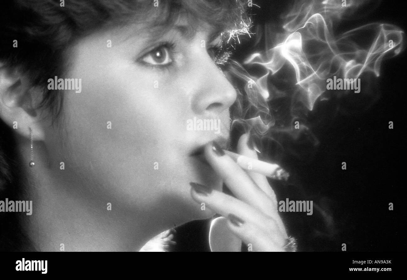 https://c8.alamy.com/comp/AN9A3K/girl-smoking-in-studio-shot-with-back-lighting-to-the-smoke-AN9A3K.jpg