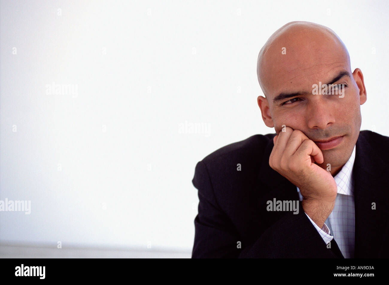 Businessman deep in thought - Stock Image
