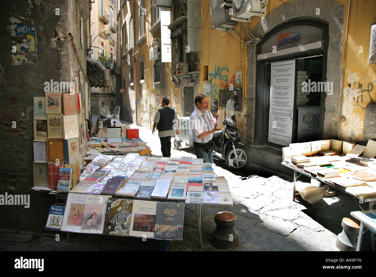A book seller in the old quarter of Naples Italy - Stock Image