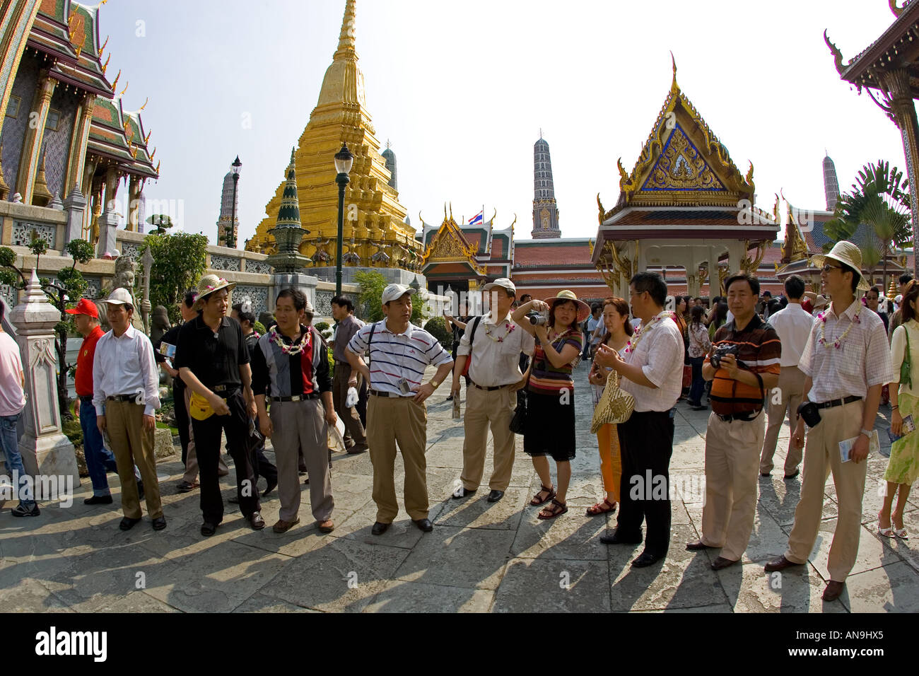 Tourists visit the Grand Palace Complex in Bangkok Thailand Stock Photo
