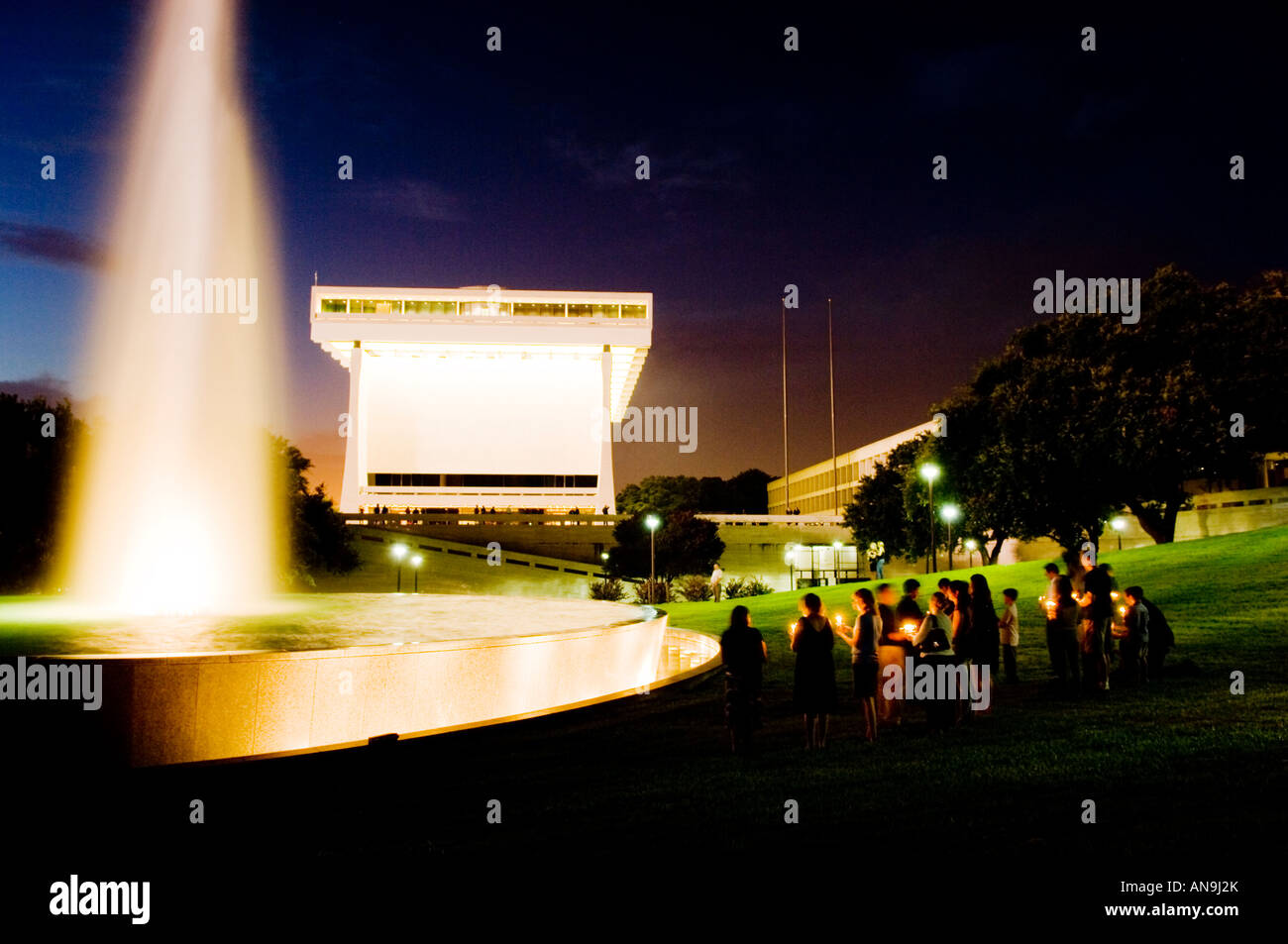 Mourners Holding Candlelight Vigil at LBJ Library Following Death of Lady Bird Johnson Stock Photo