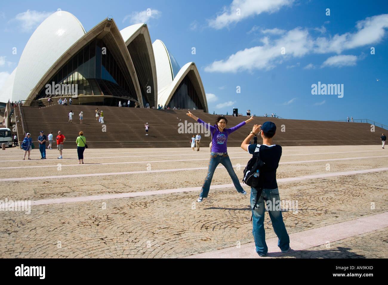 Tourists taking photographs at Sydney Opera House New South Wales Australia Stock Photo